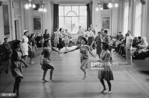 Patients participating in a therapeutic country dance session at a mental hospital in England November 1946 Original publication Picture Post 4254...