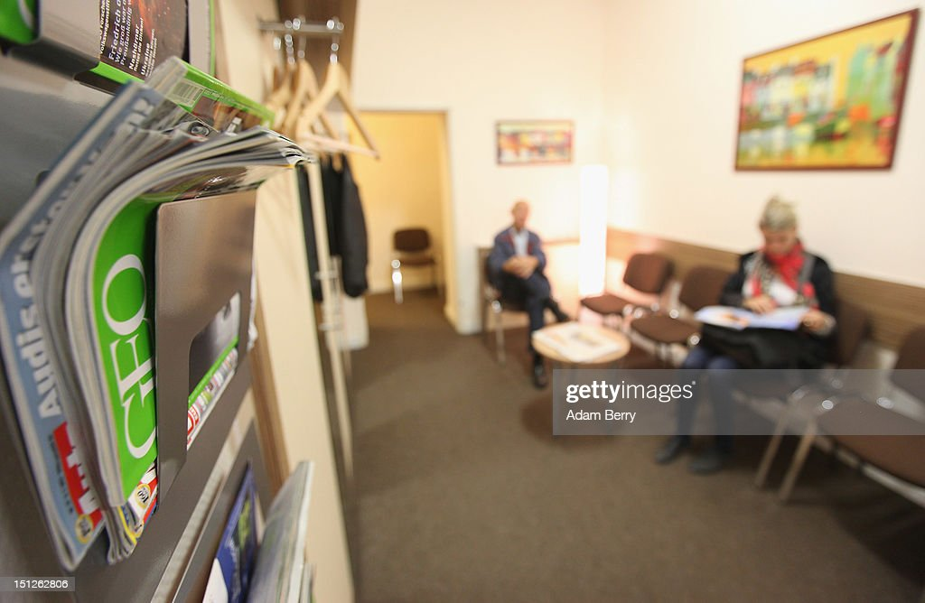 Patients sit in a doctor's waiting room on September 5, 2012 in Berlin, Germany. Doctors in the country are demanding higher payments from health insurance companies (Krankenkassen). Over 20 doctors' associations are expected to hold a vote this week over possible strikes and temporary closings of their practices if assurances that a requested additional annual increase of 3.5 billion euros (4,390,475,550 USD) in payments are not provided. The Kassenaerztlichen Bundesvereinigung (KBV), the National Association of Statutory Health Insurance Physicians, unexpectedly broke off talks with the health insurance companies on Monday.