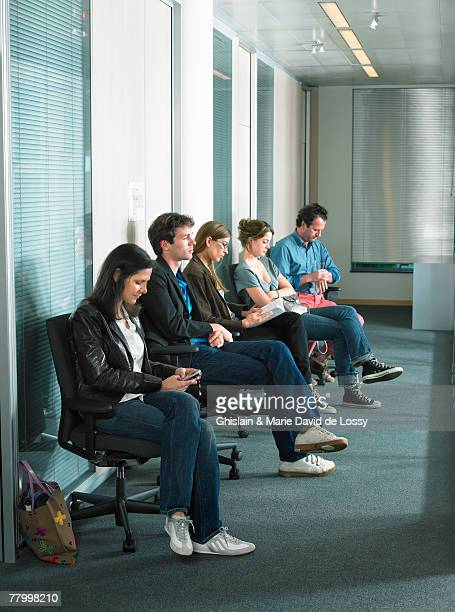Patients sitting in waiting room of a hospital.