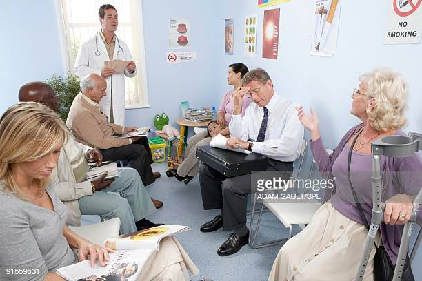 Patients sitting on chair in hospital