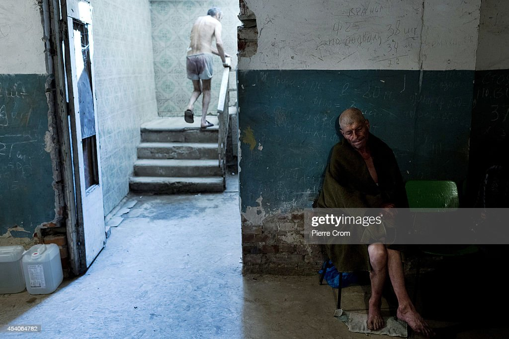 Patients take cover in the basement of a hospital after it was hit by early morning artillery fire on August 24, 2014 in Donetsk , Ukraine. In the last few days, several neighborhoods in Donetsk have been hit with sustained artillery fire, with deadly attacks on Wednesday and Saturday, and fighting on the city's outskirts has become more intense.