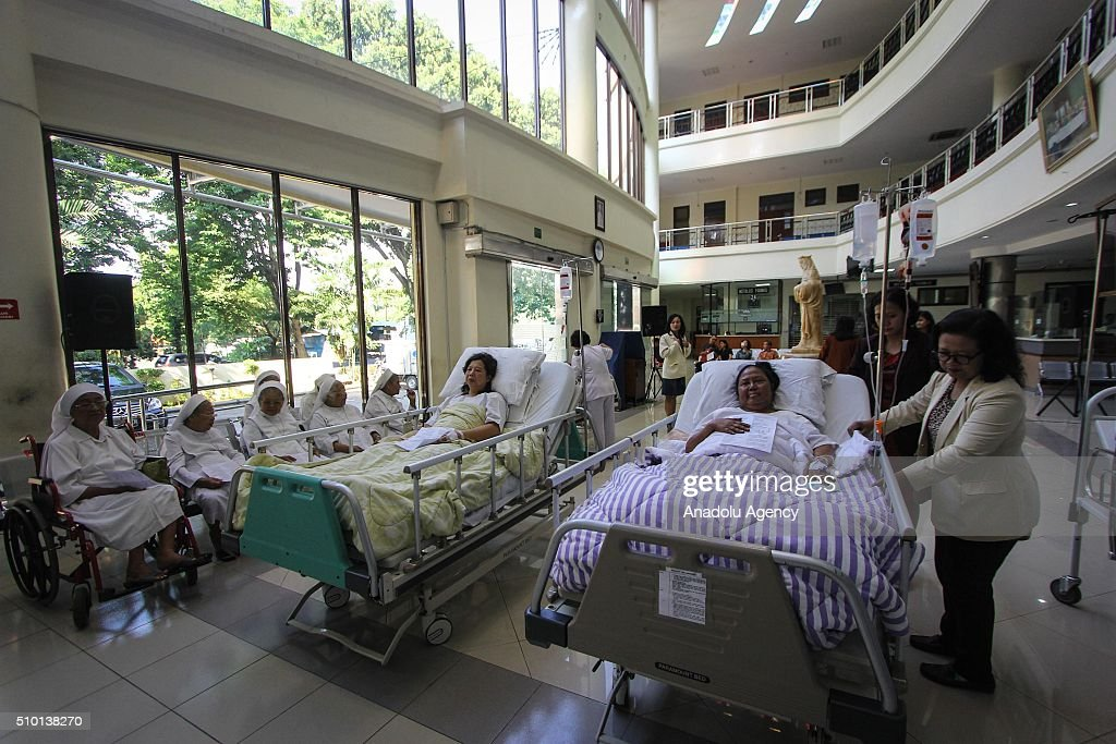 Patients takes part in the early morning mass marking the World Day of the Sick at the chapel of Elisabeth Hospital in Semarang, Indonesia on February 14, 2016. The World Day of the Sick is a feast day of the Roman Catholic Church which was instituted on May 13, 1992 by Pope John Paul II and beginning on February 11, 1993.