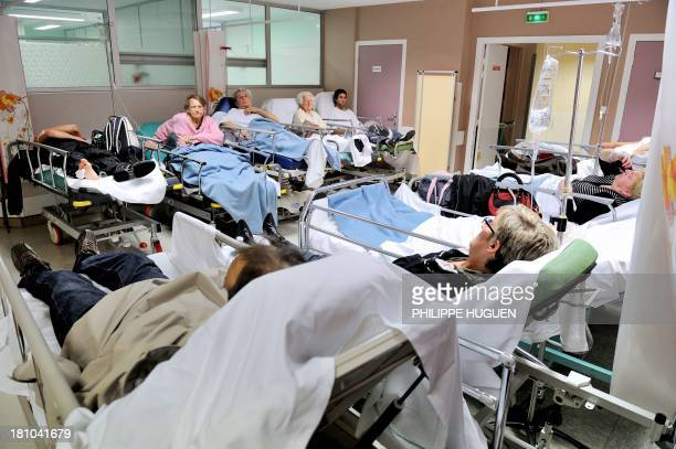 Patients wait in the emergency room of a hospital in Lens northern France on September 18 2013 AFP PHOTO / PHILIPPE HUGUEN