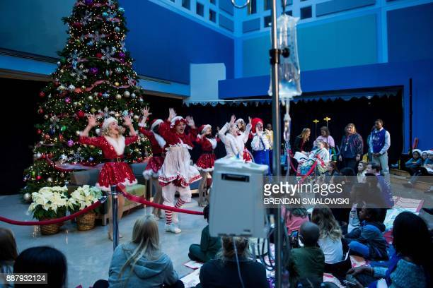 Patients watch dancers while waiting for US first lady Melania Trump at Children's National Medical Center December 7 2017 in Washington DC / AFP...