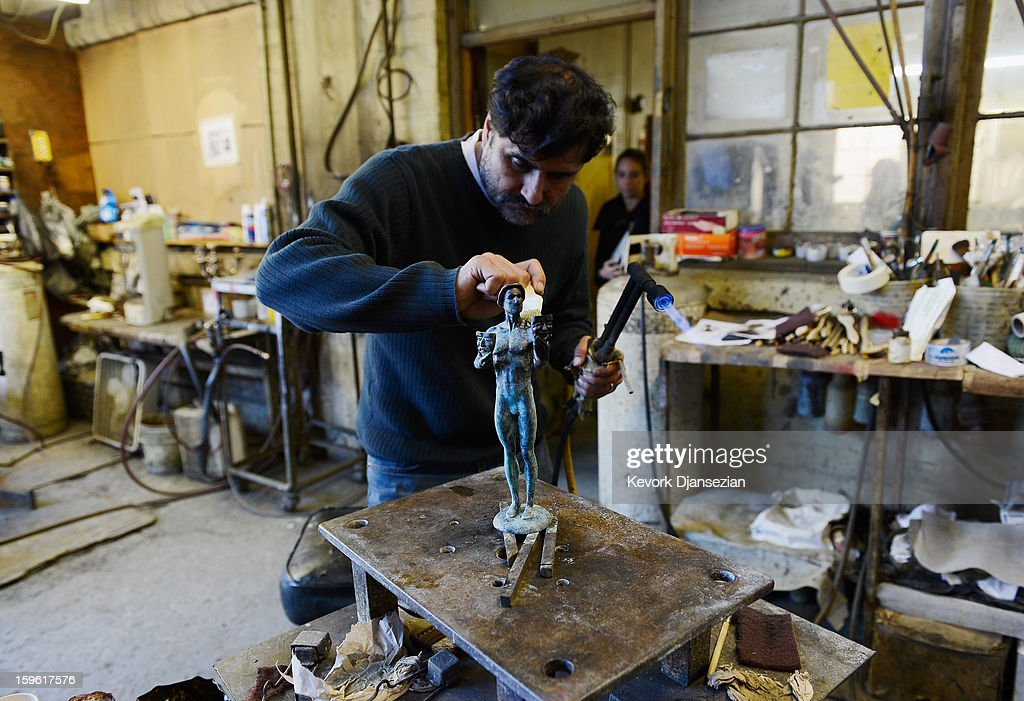 Patina artist Ricardo Godinez applies a green-black patina to one of the bronze Screen Actors Guild Award statuettes at the American Fine Arts Foundry on January 17, 2013 in Burbank, California. The 19th Annual SAG Awards, which honors outstanding motion picture and primetime television performances are to be held in Los Angeles on January 27.
