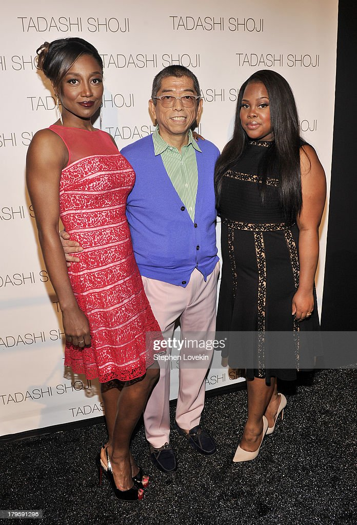 <a gi-track='captionPersonalityLinkClicked' href=/galleries/search?phrase=Patina+Miller&family=editorial&specificpeople=5748190 ng-click='$event.stopPropagation()'>Patina Miller</a>, Tadashi Shoji and <a gi-track='captionPersonalityLinkClicked' href=/galleries/search?phrase=Amber+Riley&family=editorial&specificpeople=5662111 ng-click='$event.stopPropagation()'>Amber Riley</a> prepare backstage at the Tadashi Shoji Spring 2014 fashion show during Mercedes-Benz Fashion Week at The Stage at Lincoln Center on September 5, 2013 in New York City.