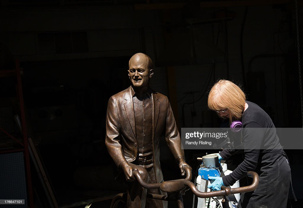 Patineur, Gayle Skalin applies patina and wax on the Jack Layton Memorial sculpture titled 'Jack's Got Your Back' at MST Bronze in Etobicoke. The sculpture is to be unveiled on the 2nd anniversary of Jack's death, August 22 at the Toronto Island Ferry Terminal.