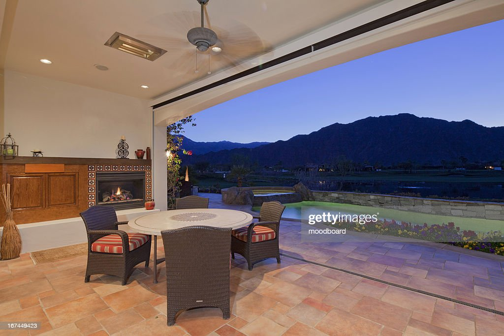 Patio and swimming pool of modern home : Stock Photo