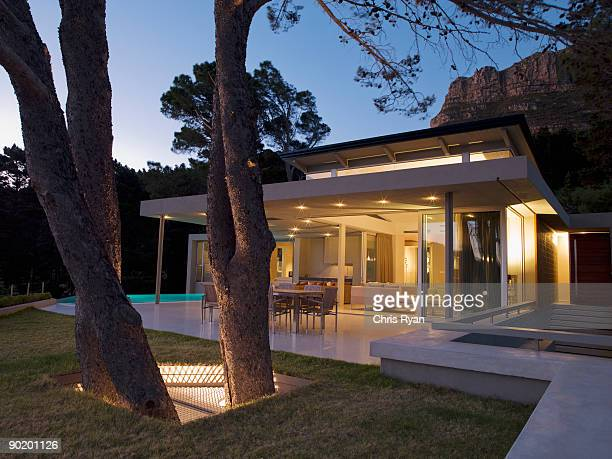 Patio area and glass walls of modern home