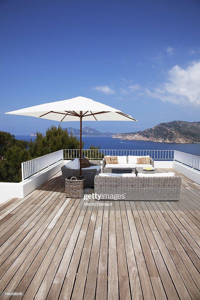 Patio furniture on modern deck : Stock Photo