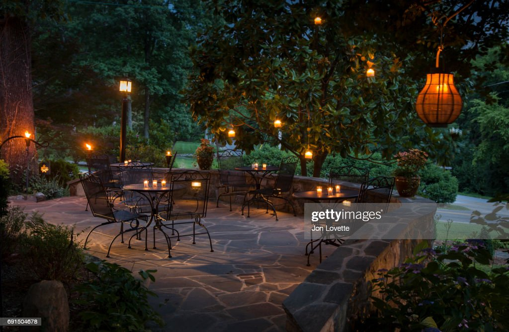 Patio Lit With Hanging Lanterns And Candles : Stock Photo