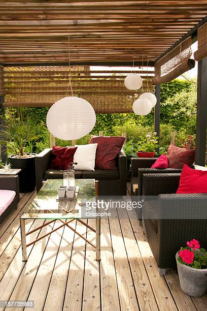 Patio with a pergola and modern outdoor furniture