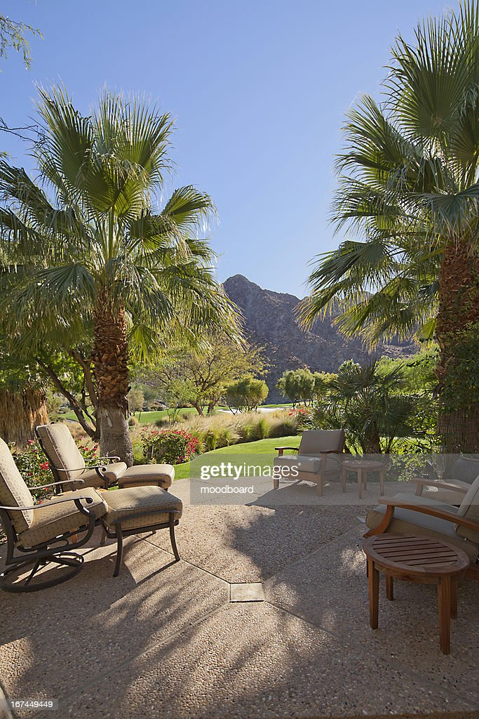 Patio with relaxing chairs and gardens : Stock Photo