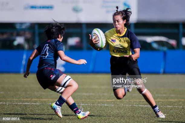 Patjayaporn Fanphimai of Thailand is tackled by Suet Ying Wong of Hong Kong during the Asia Rugby U20 Sevens 2017 at King's Park Sports Ground on...