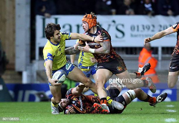 Pato Fernandez of Clermont Auvergne is caught by Jack Nowell of Exeter Chiefs during the European Rugby Champions Cup match between Exeter Chiefs and...