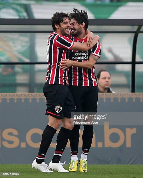 Pato of Sao Paulo celebrates scoring the first goal with Kaka during the match between Palmeiras and Sao Paulo for the Brazilian Series A 2014 at...