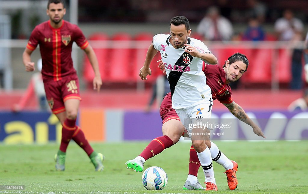 Pato (R) of Sao Paulo fights for the ball with Nene (C) of Vasco during the match between Sao Paulo and Vasco for the Brazilian Series A 2015 at Estadio do Morumbi on October 18, 2015 in Sao Paulo, Brazil.