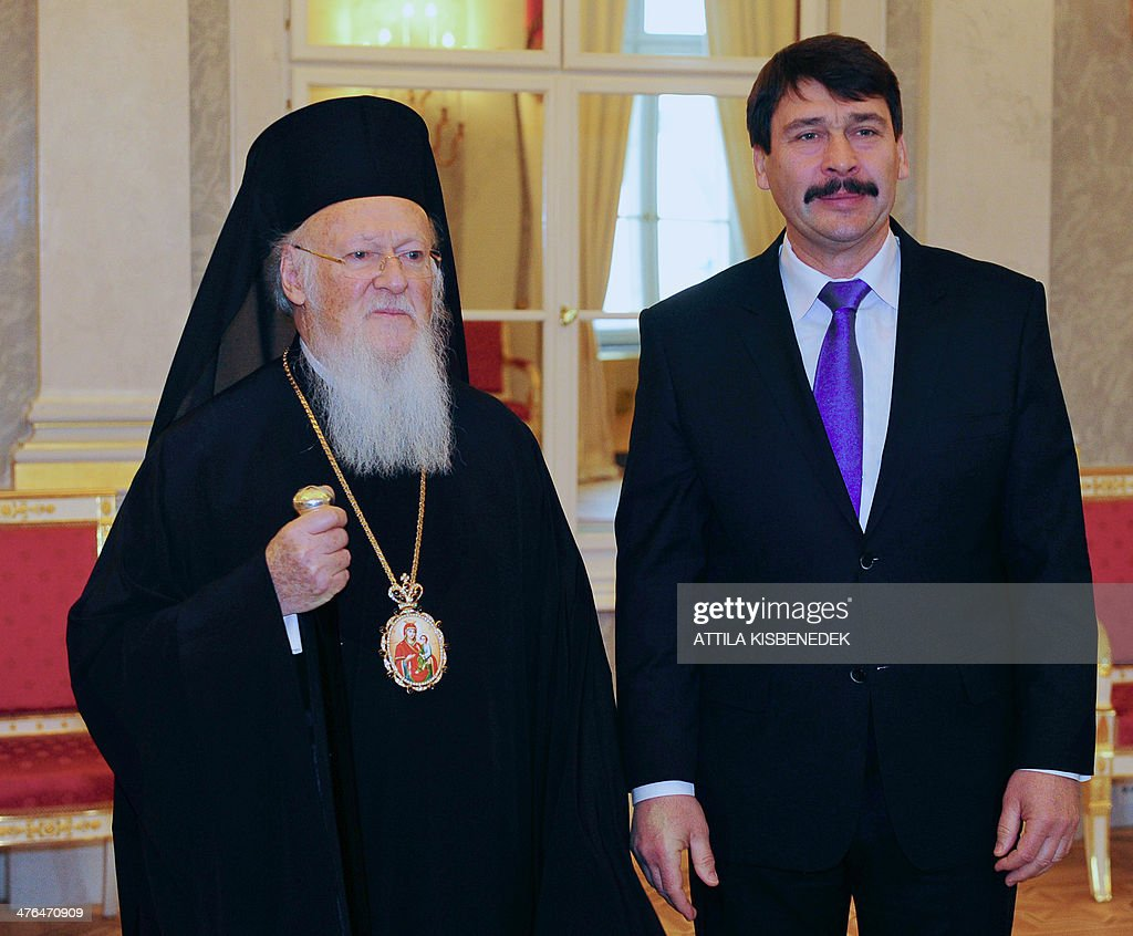 Patriarch Bartholomew I, archbishop of Constantinople and Ecumenical Patriarch (L) is welcomed by Hungarian President Janos Ader (R) in the Miror Hall of the presidental palace in Budapest on Marc 03, 2014 prior to their alks. Bartholomaios I arrived yesterday for his two-day official visit to Hungary to sign an agreement of rights for the Greek Catholic Church in Hungary by the local government.