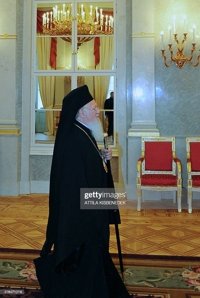 Patriarch Bartholomew I, archbishop of Constantinople and Ecumenical Patriarch arrives at the Miror Hall of the presidental palace in Budapest on Marc 03, 2014 prior to talks with Hungarian President . Bartholomaios I arrived yesterday for his two-day official visit to Hungary to sign an agreement of rights for the Greek Catholic Church in Hungary by the local government.