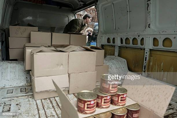 Patriarch Filaret the leader of the Ukrainian Orthodox Church of the Kyiv Patriarchate handed to servicemen canned meat purchased donations...