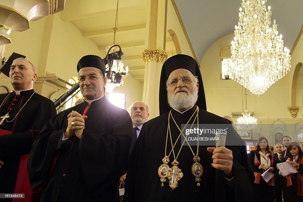 Patriarch of Antioch and All the East for Roman Catholics, Gregory III Laham (R)stands next to Maronite Patriarch Beshara Rai (2nd L) as they attend the enthronement of Syria's Greek Orthodox leader Yuhanna X Yazigi at the Holy Cross church in Damascus, during the first visit by a Maronite patriarch since Syrian independence in 1943, on February 10, 2013. Snipers were deployed on the rooftops around the church as dignitaries from Middle East churches arrived for the enthronement.