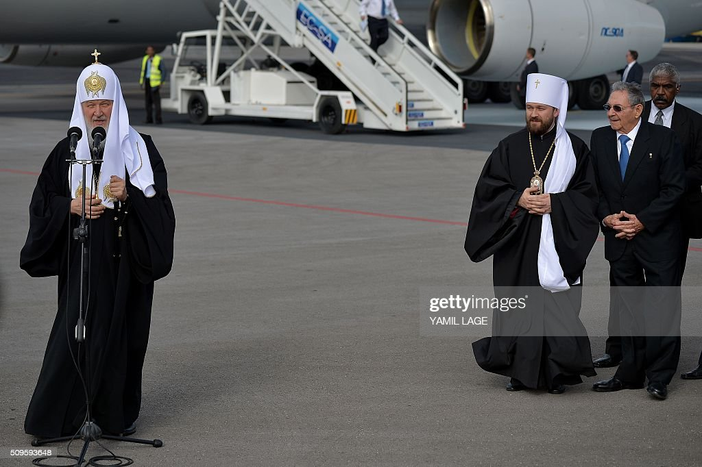 Patriarch of Moscow and All Russia and Primate of the Russian Orthodox Church, Kirill (L), delivers a speech upon his arrival at Jose Marti International airport in Havana, on February 11, 2016, near Cuban President Raul Castro (R). Russian Patriarch Kirill arrives in Cuba for an official visit during which he will meet with Pope Francis, a dialogue that seeks rapprochement between the two churches. AFP PHOTO/YAMIL LAGE / AFP / YAMIL LAGE