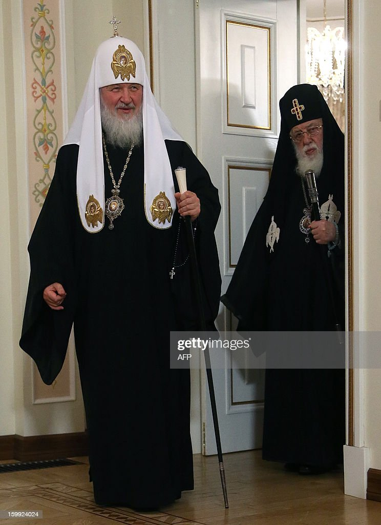 Patriarch of Moscow and All Russia Kirill (L) and Catholicos Patriarch Ilia II of All Georgia (R) enter the hall for their meeting with Russia's President Vladimir Putin in the Novo-Ogaryovo residence outside Moscow, on January 23, 2013. Georgia's Orthodox Church leader passed a greeting from Prime Minister Bidzina Ivanishvili to Putin as he became the most senior Tbilisi figure to visit Moscow since the two sides' brief 2008 war.