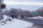 Patric Batie walks along a road in Burns Oregon January 3 some 30 miles from the Malheur National Wildlife Headquarters where a group of armed...