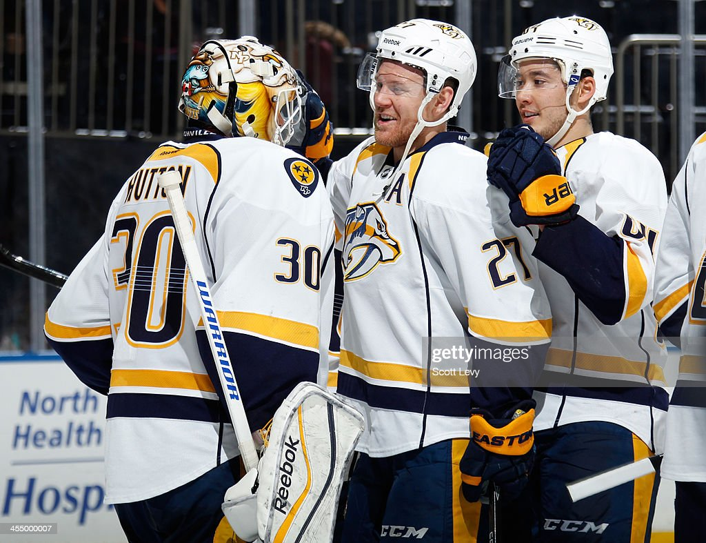 <a gi-track='captionPersonalityLinkClicked' href=/galleries/search?phrase=Patric+Hornqvist&family=editorial&specificpeople=1966879 ng-click='$event.stopPropagation()'>Patric Hornqvist</a> #27 and <a gi-track='captionPersonalityLinkClicked' href=/galleries/search?phrase=Carter+Hutton&family=editorial&specificpeople=6872781 ng-click='$event.stopPropagation()'>Carter Hutton</a> #30 of the Nashville Predators celebrate following a 4-1 win over the New York Rangers at Madison Square Garden on December 10, 2013 in New York City.