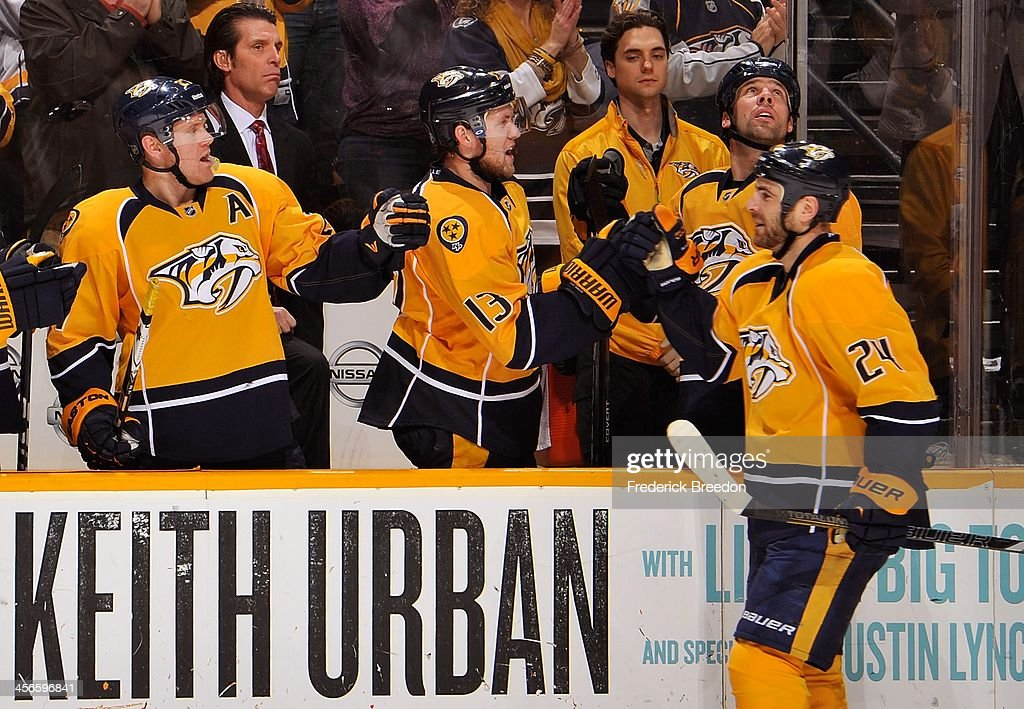 Patric Hornqvist and Nick Spaling of the Nashville Predators congratulate teammate Eric Nystrom on scoring a goal against the San Jose Sharks at...