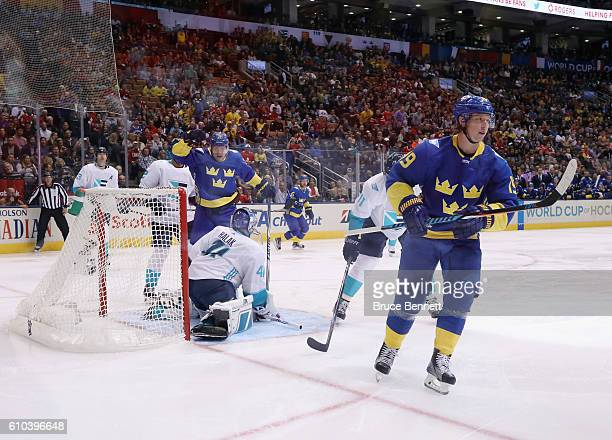 Patric Hornqvist and Nicklas Backstrom of Team Sweden celebrate a goal by Backstrom against Jaroslav Halak of Team Europe during the second period at...