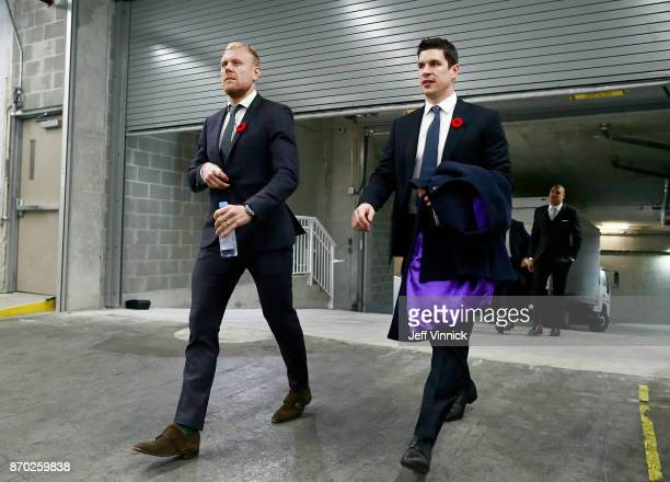 Patric Hornqvist and Sidney Crosby of the Pittsburgh Penguins walk to their dressing room before their NHL game against the Vancouver Canucks at...