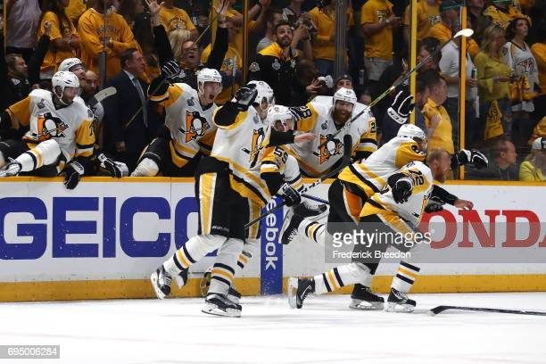 Patric Hornqvist and the bench of the Pittsburgh Penguins celebrate after defeating the Nashville Predators 20 to win the 2017 NHL Stanley Cup Final...