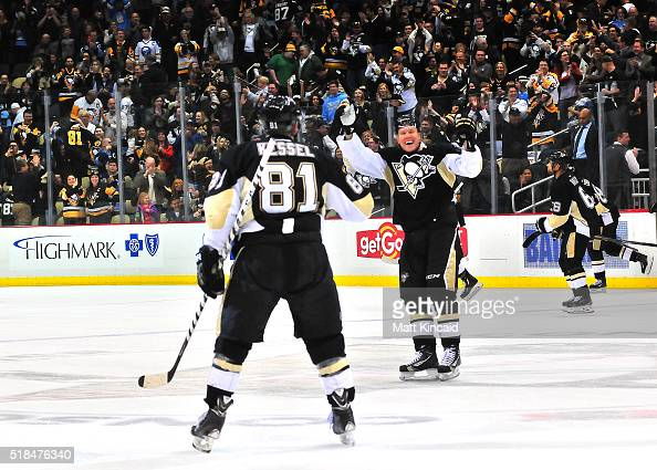 Patric Hornqvist celebrates after Phil Kessel of the Pittsburgh Penguins scores the game winning goal in a shootout against the Buffalo Sabres at...