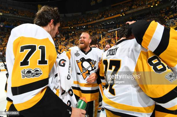 Patric Hornqvist Evgeni Malkin and their Pittsburgh Penguins teammates celebrate after Game Six of the 2017 NHL Stanley Cup Final at the Bridgestone...