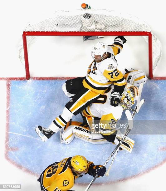 Patric Hornqvist falls on top of Matt Murray of the Pittsburgh Penguins during the third period against the Nashville Predators in Game Four of the...