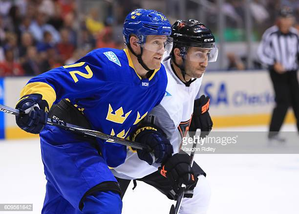 Patric Hornqvist of Team Sweden battles for position with Vincent Trocheck of Team North America during the World Cup of Hockey 2016 at Air Canada...