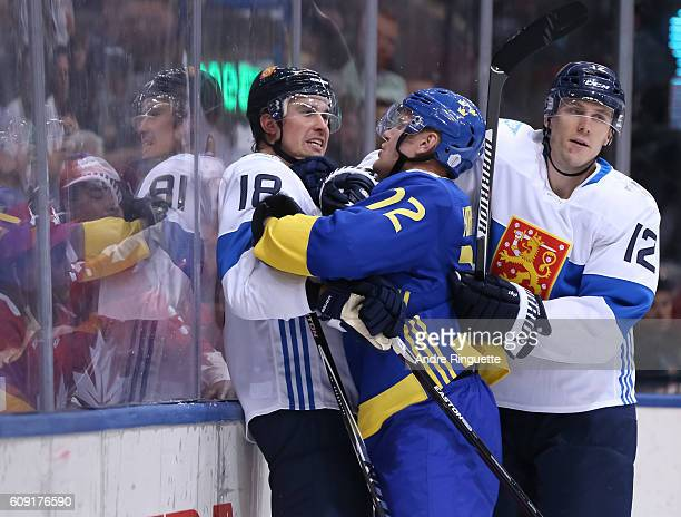 Patric Hornqvist of Team Sweden clashes with Sami Lepisto and Jori Lehtera of Team Finland during the World Cup of Hockey 2016 at Air Canada Centre...