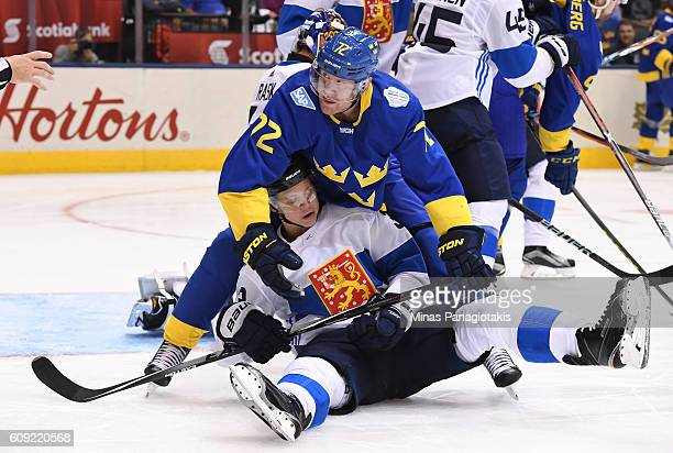 Patric Hornqvist of Team Sweden gets tangled up with Olli Maatta of Team Finland during the World Cup of Hockey 2016 at Air Canada Centre on...