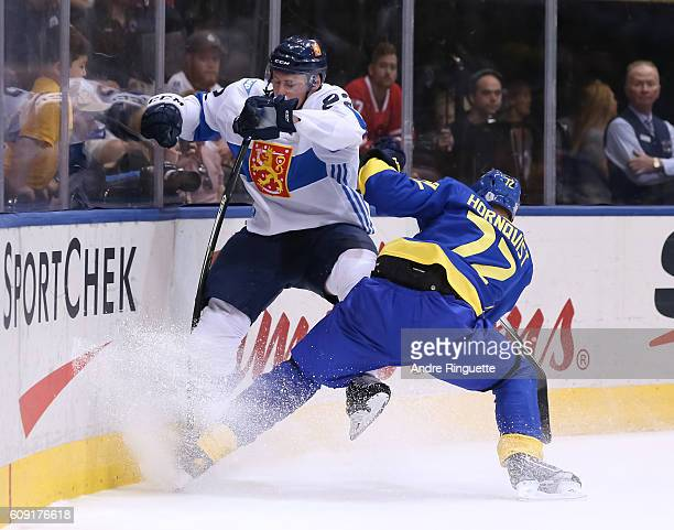 Patric Hornqvist of Team Sweden hits Ville Pokka of Team Finland into the boards during the World Cup of Hockey 2016 at Air Canada Centre on...