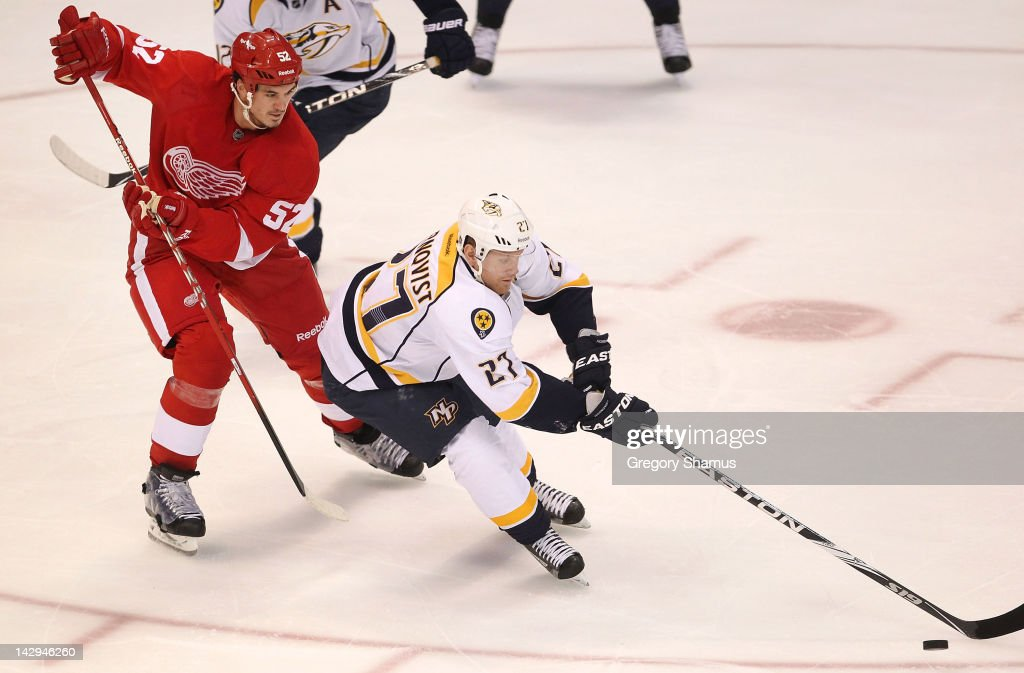 <a gi-track='captionPersonalityLinkClicked' href=/galleries/search?phrase=Patric+Hornqvist&family=editorial&specificpeople=1966879 ng-click='$event.stopPropagation()'>Patric Hornqvist</a> #27 of the Nashville Predators controls the puck in front of <a gi-track='captionPersonalityLinkClicked' href=/galleries/search?phrase=Jonathan+Ericsson&family=editorial&specificpeople=2538498 ng-click='$event.stopPropagation()'>Jonathan Ericsson</a> #52 of the Detroit Red Wings during Game Three of the Western Conference Quarterfinals during the 2012 NHL Stanley Cup Playoffs at Joe Louis Arena on April 15, 2012 in Detroit, Michigan.