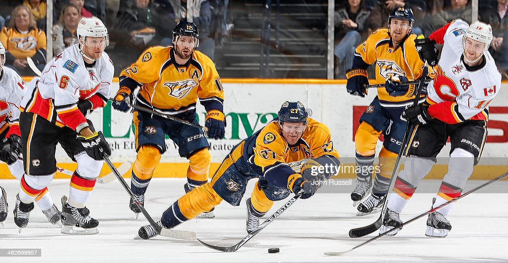 <a gi-track='captionPersonalityLinkClicked' href=/galleries/search?phrase=Patric+Hornqvist&family=editorial&specificpeople=1966879 ng-click='$event.stopPropagation()'>Patric Hornqvist</a> #27 of the Nashville Predators dives to clear the puck during a Calgary Flames' power play at Bridgestone Arena on January 14, 2014 in Nashville, Tennessee.