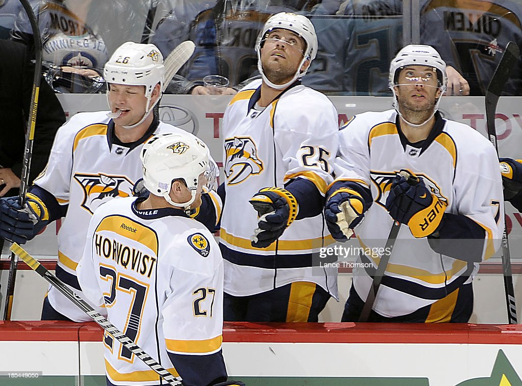 <a gi-track='captionPersonalityLinkClicked' href=/galleries/search?phrase=Patric+Hornqvist&family=editorial&specificpeople=1966879 ng-click='$event.stopPropagation()'>Patric Hornqvist</a> #27 of the Nashville Predators gets congratulated by teammates <a gi-track='captionPersonalityLinkClicked' href=/galleries/search?phrase=Matt+Hendricks&family=editorial&specificpeople=4537275 ng-click='$event.stopPropagation()'>Matt Hendricks</a> #26, Viktor Salberg #25 and <a gi-track='captionPersonalityLinkClicked' href=/galleries/search?phrase=Matt+Cullen&family=editorial&specificpeople=536122 ng-click='$event.stopPropagation()'>Matt Cullen</a> #7 at the bench after scoring a goal against the Winnipeg Jets in second period action at the MTS Centre on October 20, 2013 in Winnipeg, Manitoba, Canada.