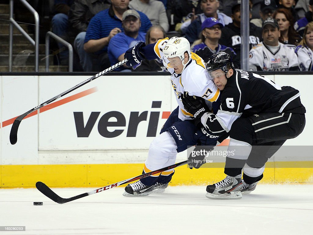 Patric Hornqvist #27 of the Nashville Predators is checked by Jake Muzzin #6 of the Los Angeles Kings during the first period at Staples Center on March 4, 2013 in Los Angeles, California.