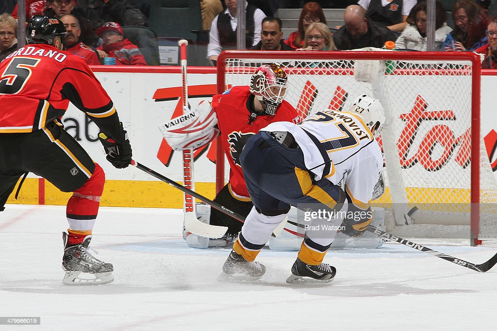 <a gi-track='captionPersonalityLinkClicked' href=/galleries/search?phrase=Patric+Hornqvist&family=editorial&specificpeople=1966879 ng-click='$event.stopPropagation()'>Patric Hornqvist</a> #27 of the Nashville Predators scores a goal against <a gi-track='captionPersonalityLinkClicked' href=/galleries/search?phrase=Joni+Ortio&family=editorial&specificpeople=4779725 ng-click='$event.stopPropagation()'>Joni Ortio</a> #37 and <a gi-track='captionPersonalityLinkClicked' href=/galleries/search?phrase=Mark+Giordano&family=editorial&specificpeople=696867 ng-click='$event.stopPropagation()'>Mark Giordano</a> #5 at Scotiabank Saddledome on March 21, 2014 in Calgary, Alberta, Canada.