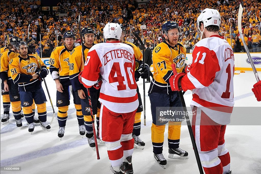 Patric Hornqvist #27 of the Nashville Predators shakes hands with Danny Cleary #11 of the Detroit Red Wings after the Predators defeat the Red Wings in Game Five of the Western Conference Quarterfinals during the 2012 NHL Stanley Cup Playoffs at the Bridgestone Arena on April 20, 2012 in Nashville, Tennessee.