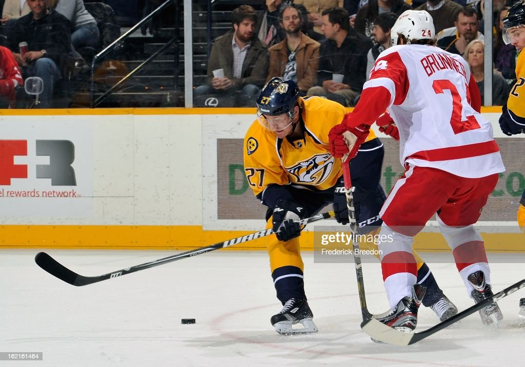 <a gi-track='captionPersonalityLinkClicked' href=/galleries/search?phrase=Patric+Hornqvist&family=editorial&specificpeople=1966879 ng-click='$event.stopPropagation()'>Patric Hornqvist</a> #27 of the Nashville Predators skates against <a gi-track='captionPersonalityLinkClicked' href=/galleries/search?phrase=Damien+Brunner&family=editorial&specificpeople=6931570 ng-click='$event.stopPropagation()'>Damien Brunner</a> #24 of the Detroit Red Wings at the Bridgestone Arena on February 19, 2013 in Nashville, Tennessee.