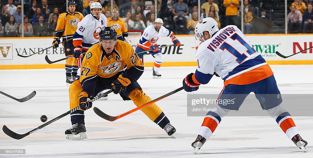 <a gi-track='captionPersonalityLinkClicked' href=/galleries/search?phrase=Patric+Hornqvist&family=editorial&specificpeople=1966879 ng-click='$event.stopPropagation()'>Patric Hornqvist</a> #27 of the Nashville Predators skates against <a gi-track='captionPersonalityLinkClicked' href=/galleries/search?phrase=Lubomir+Visnovsky&family=editorial&specificpeople=210657 ng-click='$event.stopPropagation()'>Lubomir Visnovsky</a> #11 of the New York Islanders at Bridgestone Arena on October 12, 2013 in Nashville, Tennessee.
