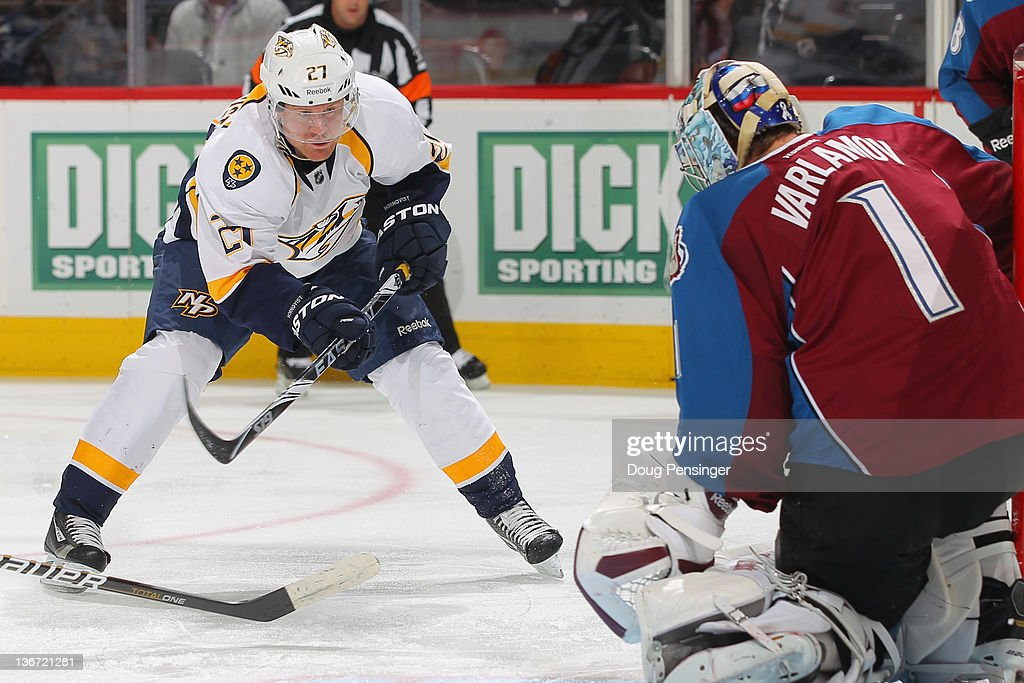 Patric Hornqvist #27 of the Nashville Predators takes a shot at goalie Semyon Varlamov #1 of the Colorado Avalanche at the Pepsi Center on January 10, 2012 in Denver, Colorado. The Predators defeated the Avalanche 4-1.