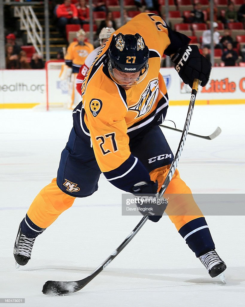 <a gi-track='captionPersonalityLinkClicked' href=/galleries/search?phrase=Patric+Hornqvist&family=editorial&specificpeople=1966879 ng-click='$event.stopPropagation()'>Patric Hornqvist</a> #27 of the Nashville Predators takes a slap shot against the Detroit Red Wings during a NHL game at Joe Louis Arena on February 23, 2013 in Detroit, Michigan. The Wings won 4-0